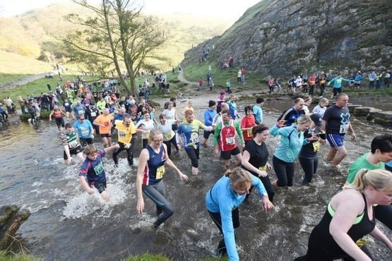 DEGM20151101C-054_C.JPG Picture - Geoff Girvan-Merryweather Dovedale, Near Ashbourne, Derbyshire - The 2015 Dovedale Dash cross country race. Winner for the fourth time was Stuart Bond, from Baslow. Runners make their way through the river
